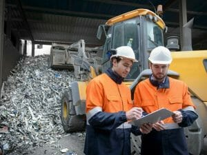 A photo of workers at an electronic recycling plant