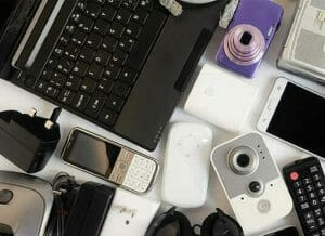 A photo of old electrical items ready for recycling