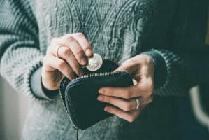 photo of person holding wallet with cash