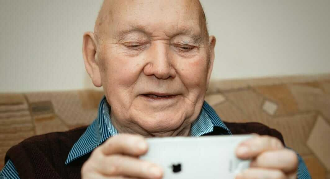 photo of man with iphone