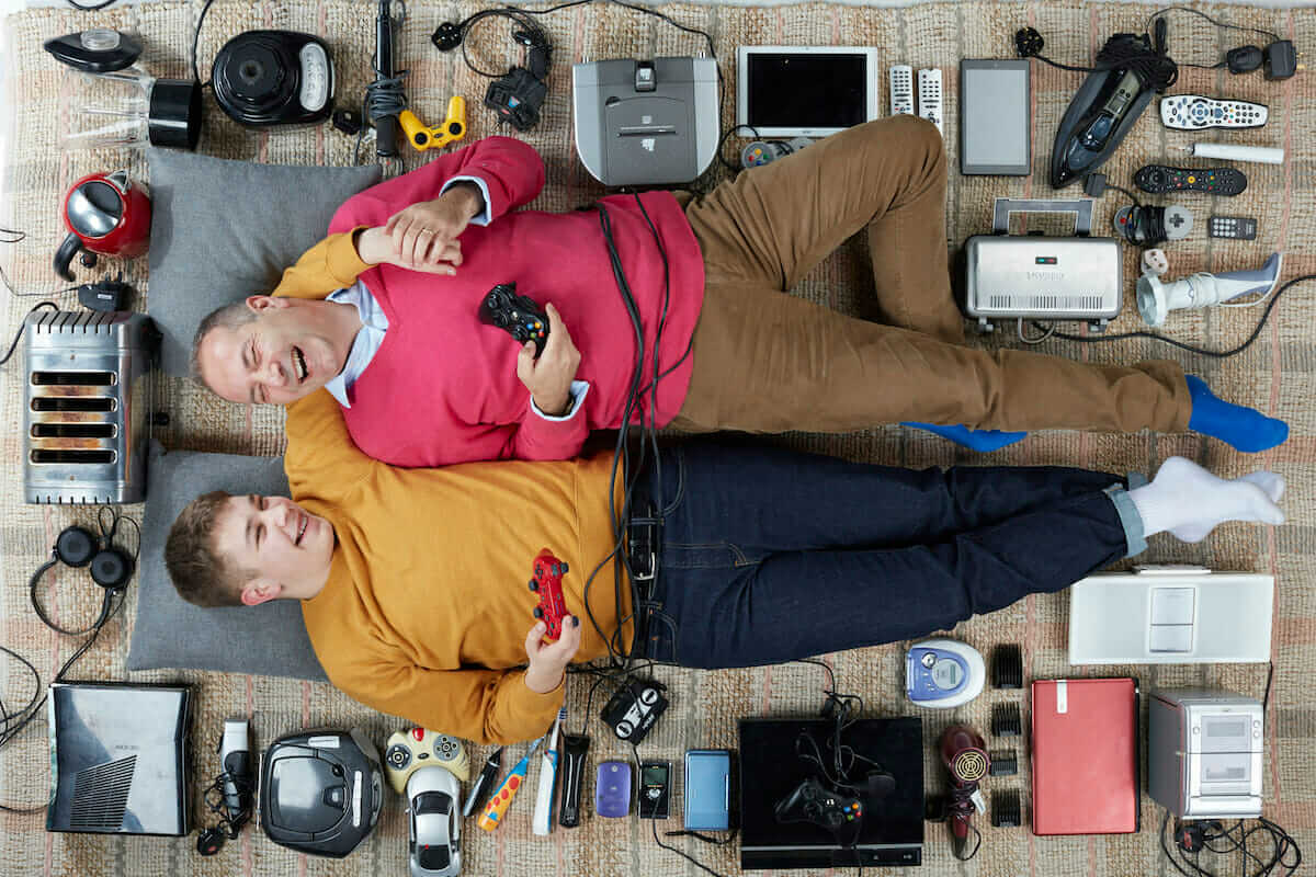 Portrait of Paul and son surrounded by electrical items