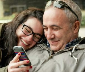 woman and man using a mobile phone