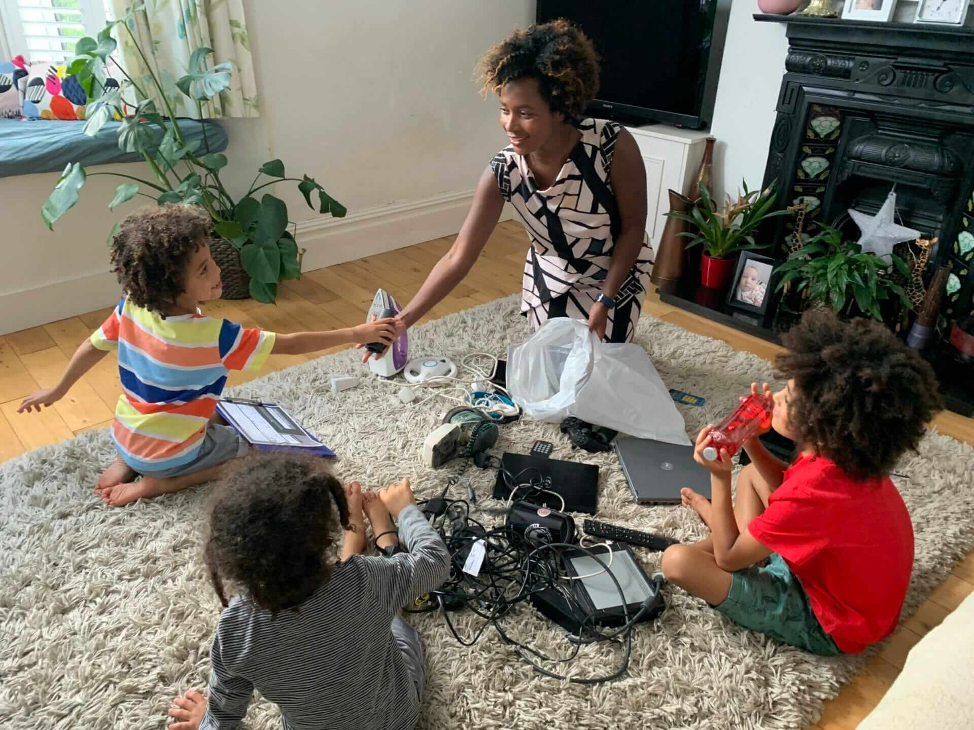 mother and children sorting old electrical items