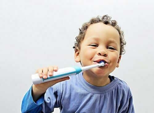 Child using electronic toothbrush