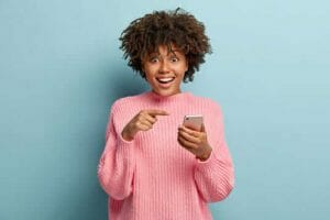 young woman with mobile phone smiling