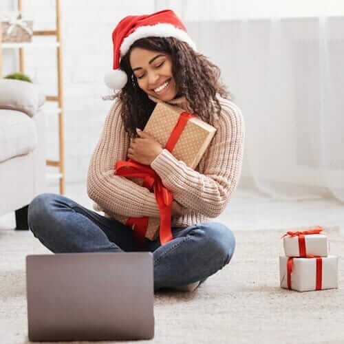 a woman holding a christmas gift