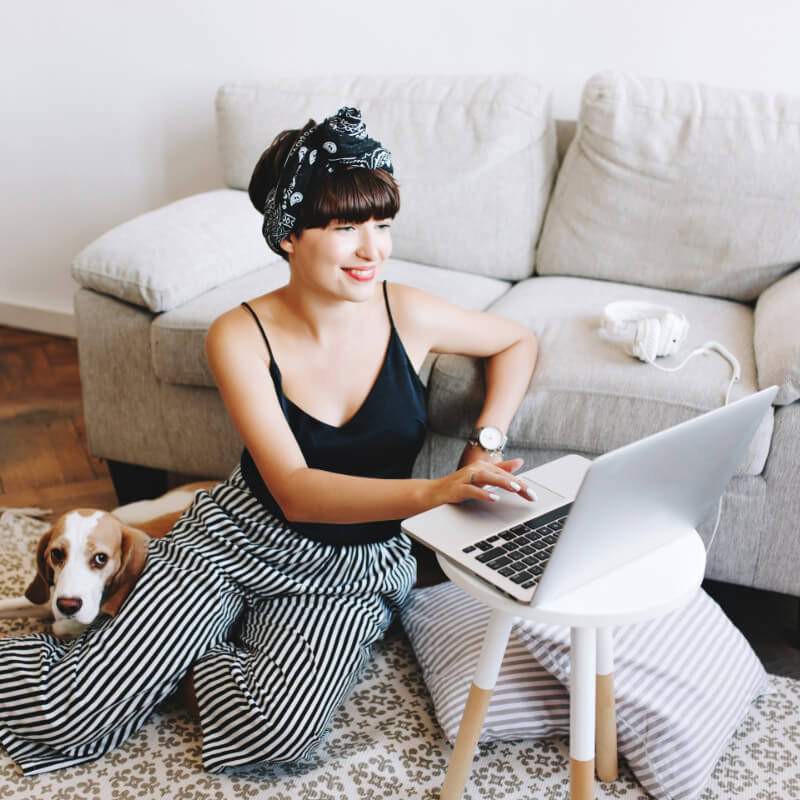 Woman sitting on the floor with a laptop