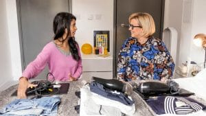 Photo of Konnie Huq and Nicola Lewis sorting old electricals