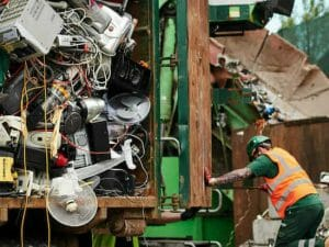 Worker at electrical recycling centre