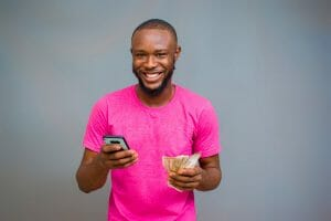 Man with mobile phone and cash