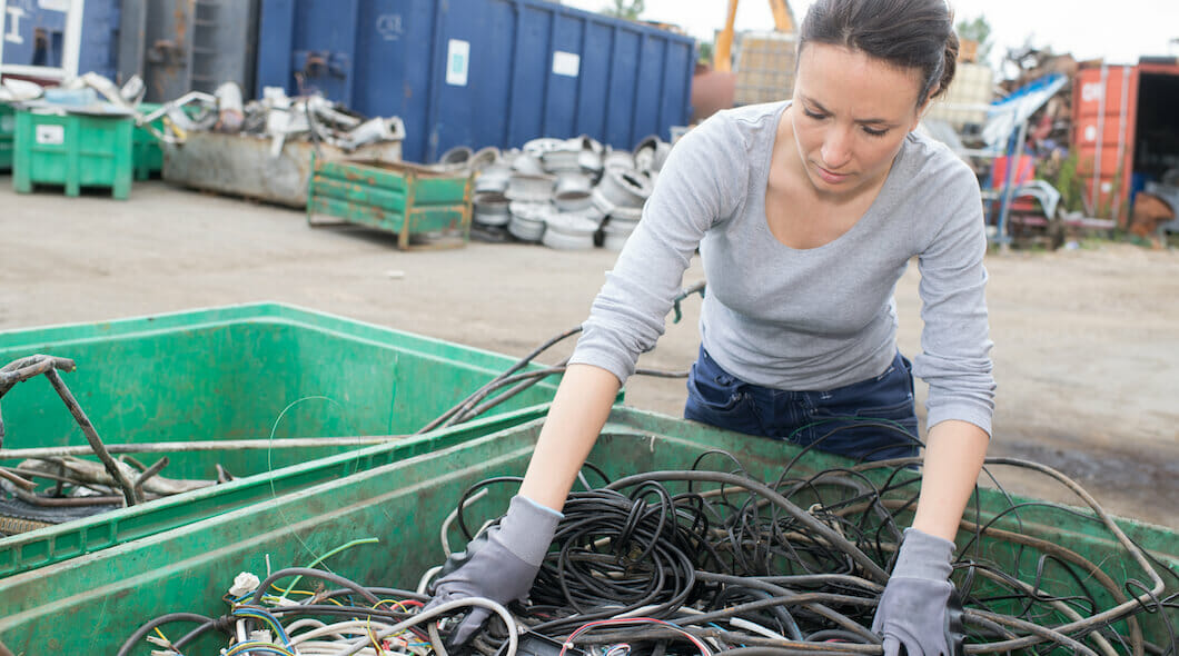 woman sorting cables for recycling