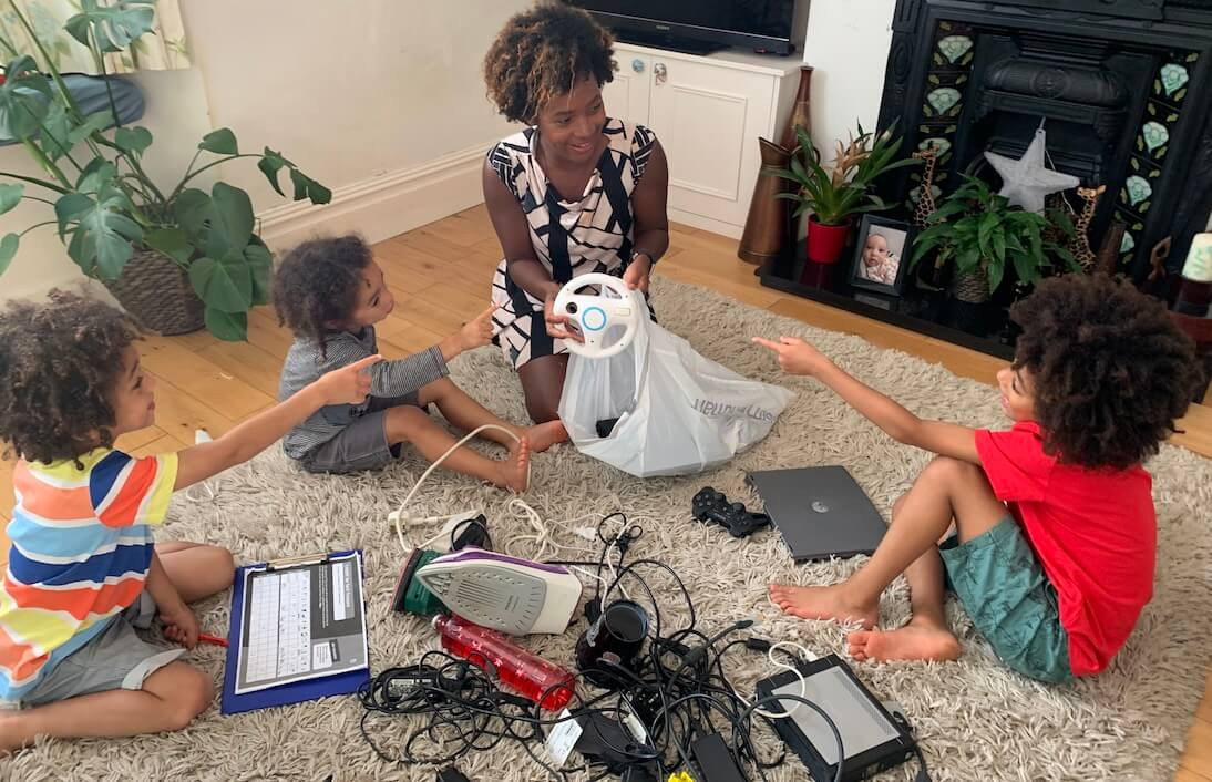 Young family sorting electricals to recycle